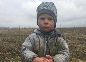 Шукали сотні людей і навіть вертоліт: під Києвом знайшли дворічного Богдана, фото