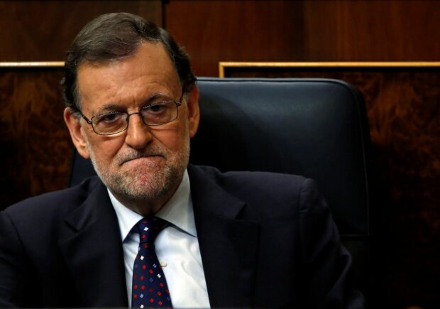 Spain's acting Prime Minister and People's Party leader Mariano Rajoy attends an investi