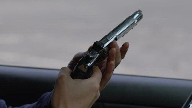 depositphotos_219333468-stock-video-armed-contract-killer-shooting-victim