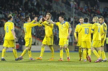 Ukraine's players celebrate a goal against Luxembourg during their Euro 2016 qualification soc