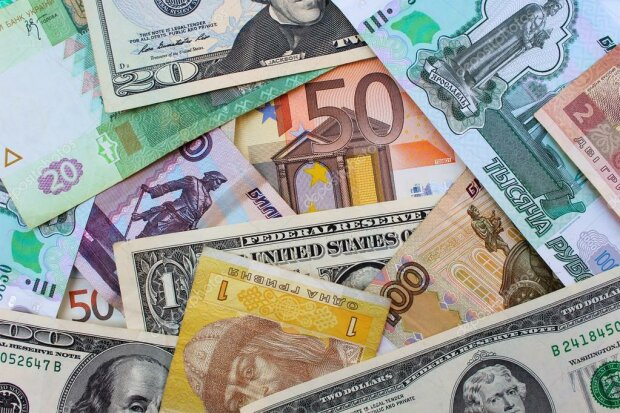 depositphotos_97414054-stock-photo-money-from-different-countries-dollars