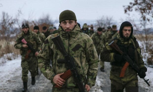 Pro-Russian separatists from the Chechen «Death» battalion walk during a training exercise