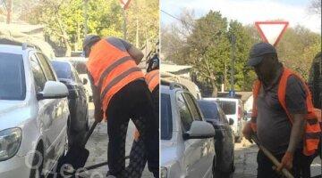 В Одессе укладывают асфальт под припаркованные авто: кадры отчаянной работы