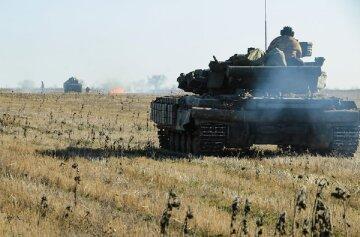 Вибухи стрясають Донбас, у хід пішли танки і артилерія: кадри з передової