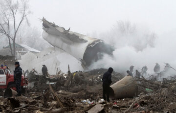 Rescue teams are seen at the crash site of Turkish cargo jet near Kyrgyzstan's Manas airport o