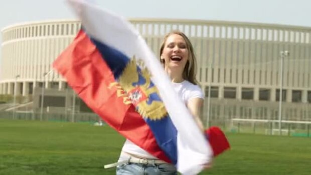 depositphotos_193040692-stock-video-woman-with-the-flag-of
