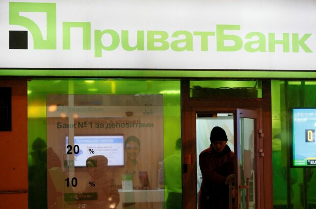 File photo of a man leaving branch of Privatbank in Kiev