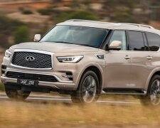 2018 Infiniti QX80 Review Champagne Quartz Front End Driving