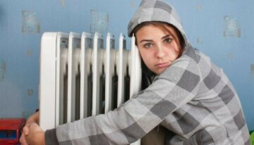 cold-girl-hugging-radiator