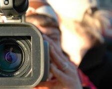 видеокамера журналист