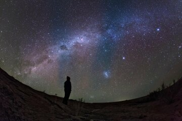 A stargazer watches the southern view of the Milky Way from the Altiplano in northern Chile.