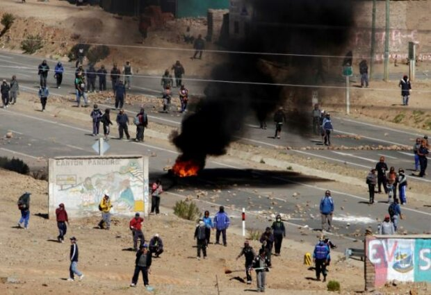 Independent miners block a main highway during a protest against Bolivia's President Evo Moral