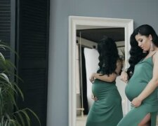 depositphotos_169251086-stock-video-beautiful-pregnant-woman-standing-near