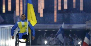 Ukraine's flag-bearer Tkachenko arrives in the stadium during the opening ceremony of the 2014
