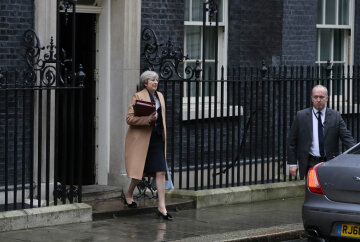 Theresa May Leaves Downing Street For Prime Minister's Questions Ahead Of The 2017 Budget