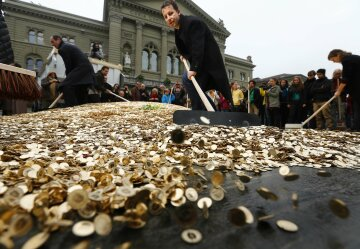 Committee members spread five cent coins over Federal Square during an event organised by the Commit