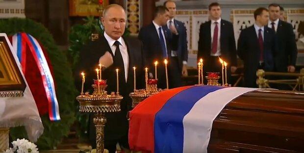 Путін на похоронах Лужкова