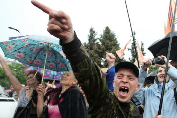 People gather for the announcement of referendum results in Lugansk